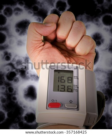 Wrist blood pressure monitor concept photograph - stock photo