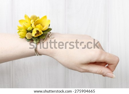 Wrist corsage made of yellow flowers - stock photo