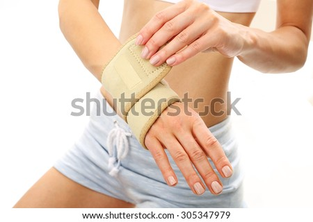Wrist, hand joint sprain. Rehabilitation of the wrist, the dressing stabilizer - stock photo