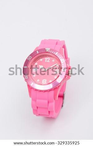 wrist watch pink on white background - stock photo