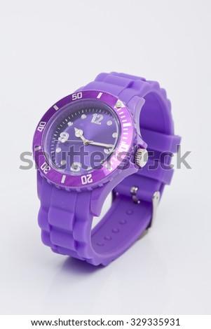 wrist watch purple on white background - stock photo
