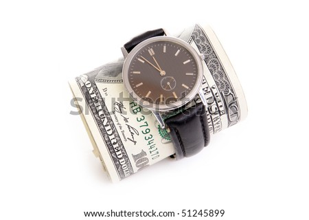 Wrist watch wrapped around a roll of 100 us dollar banknotes over white background - stock photo