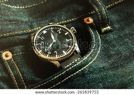 Wristwatch in jeans pocket , Time in jeans pocket , vintage Wristwatch - stock photo