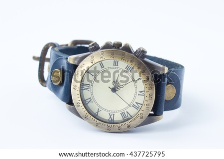 Wristwatch old with blue leather bracelet on white background, Selective focus. - stock photo
