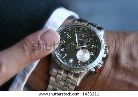 Wristwatch on a businessman - stock photo