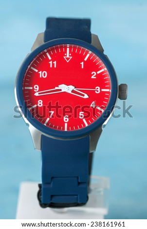 Wristwatch on blue background - stock photo