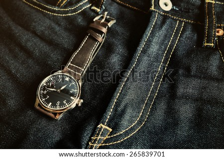 Wristwatch on jeans  , Time on jeans ,vintage Wristwatch - stock photo