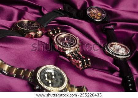 wristwatch on silk - stock photo