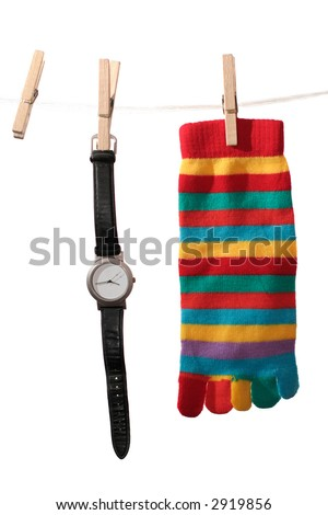 wristwatch without numbers suspended on clothes-rope along with sock. Isolated on white - stock photo