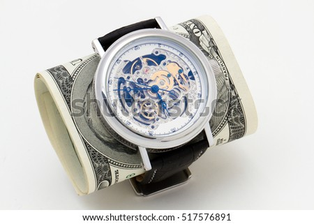 Wristwatches and hundred-dollar bills, isolated on white background