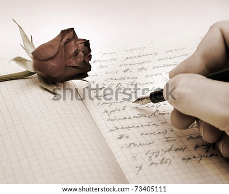 write a love letter with a rose over pink background - stock photo