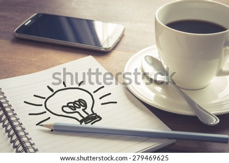 Write idea paper with coffee cup and smart phone,vintage filtered - stock photo