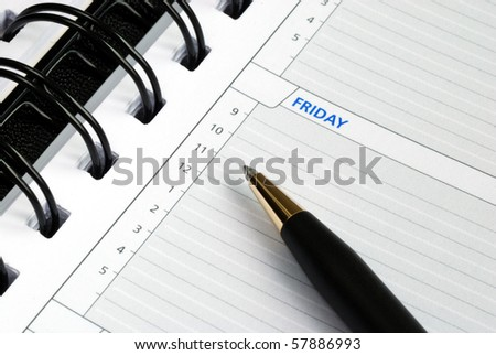 Write some notes on the day planner - stock photo