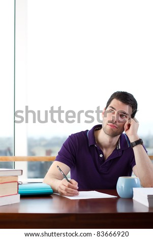 Writer lost deep in thought looking into clear space - stock photo