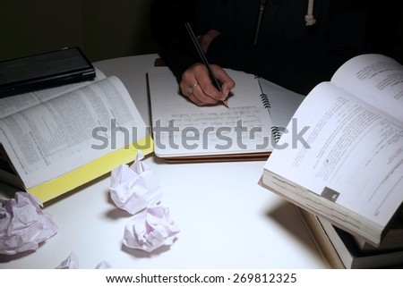 Writer thinking hard to write but not getting the idea.  - stock photo