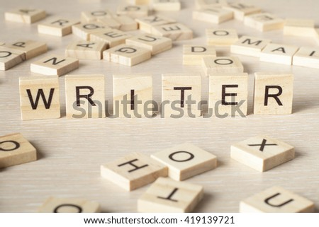 writer word written on wood block. wooden abc. - stock photo