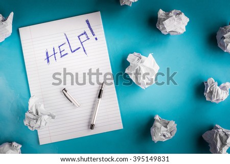 Writers block frustrated writer concept - Crumpled paper and notebook - Help - stock photo