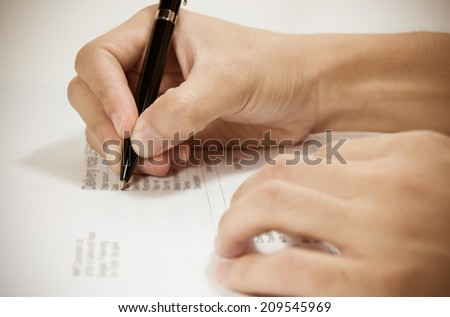 Writing a business agreement. - stock photo