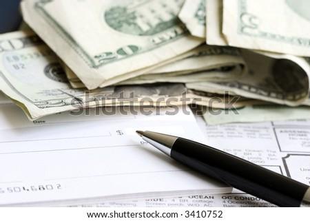 Writing a check (close up) - stock photo