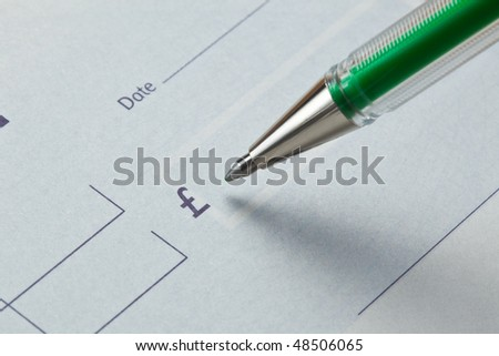 Writing a check with green ink - stock photo