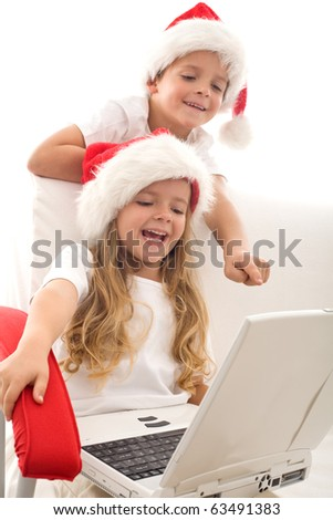 Writing a letter to santa is not what it used to be - computer generation kids emailing their christmas wishes - stock photo