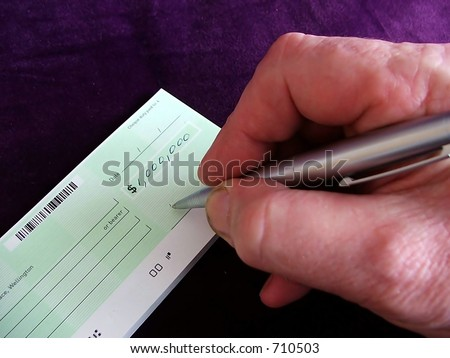 Writing a one-million-dollar check - stock photo