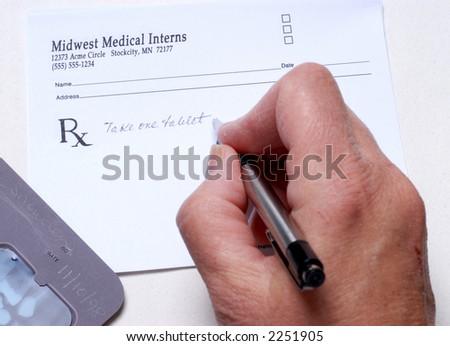 Writing a Prescription - stock photo