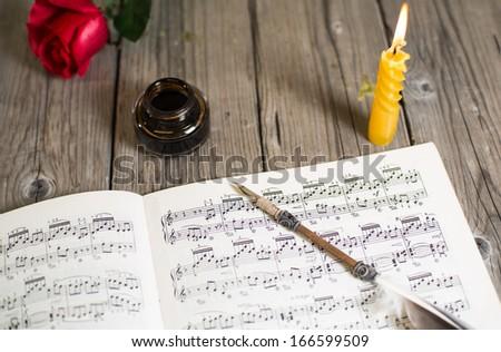 Writing a score of piano music - stock photo