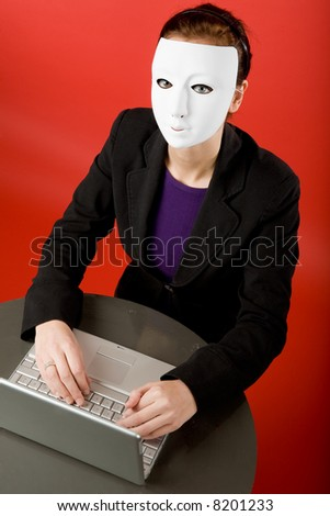Writing an message online annonymously - stock photo