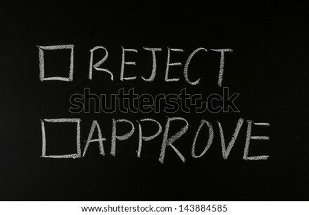writing approve or reject on blackboard - stock photo