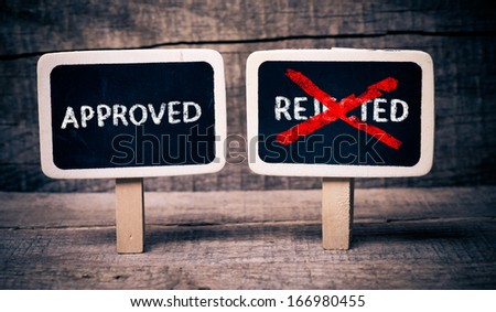 Writing approve or reject. Writing approve or reject on small blackboards on wooden background - stock photo