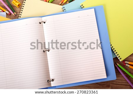 Writing book ring binder on student desk, copy space - stock photo