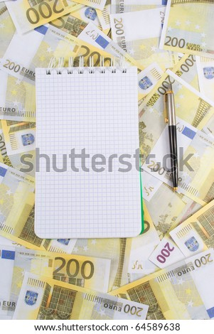 Writing-book with pen on banknotes 200 euros