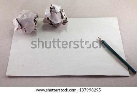 Writing concept - crumpled up paper wads with paper - stock photo