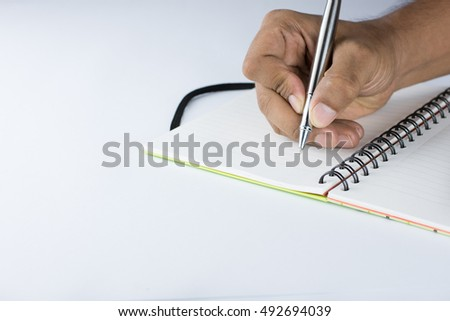 Writing hand on diary