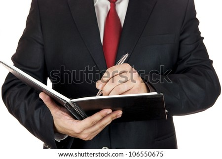 Writing hand on white page with a pen - stock photo