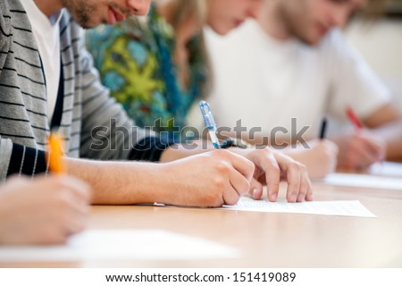 writing hands of students at course - stock photo