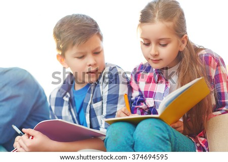 Writing in copybooks - stock photo
