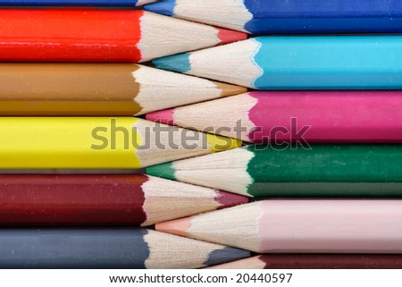 Writing materials: coloured pencils background.