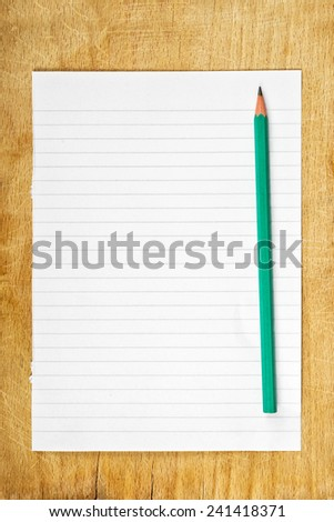 Writing Notes concept, graphite pencil and piece of blank paper as copy space on wooden table, top view - stock photo