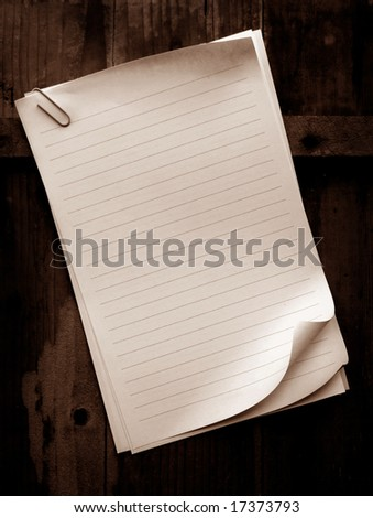 Writing old note paper on wood background - stock photo
