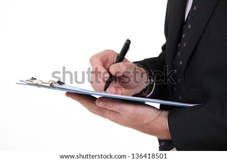 Writing on a clipboard - stock photo