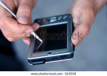 writing on a pda - stock photo