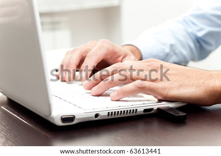 Writing on a white laptot - stock photo