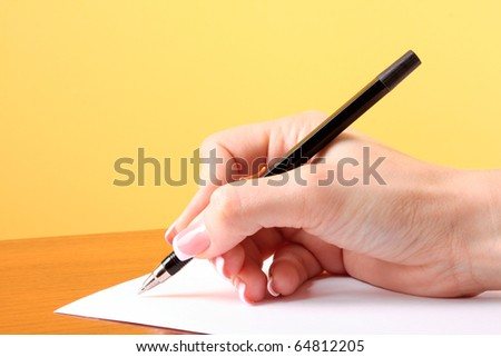 writing on blank paper, yellow background