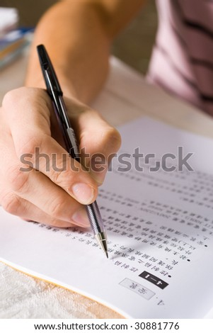 writing on book with a pen