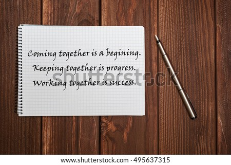 writing on the notebook. Coming together is a beginning. Keeping together is progress. Working together is success