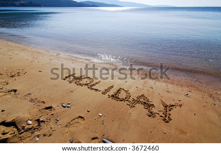 writing on the sand - stock photo