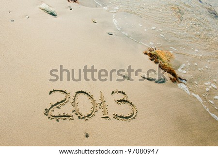writing on the sand - 2013. Summer 2013 at the sand beach - the best vacations - stock photo