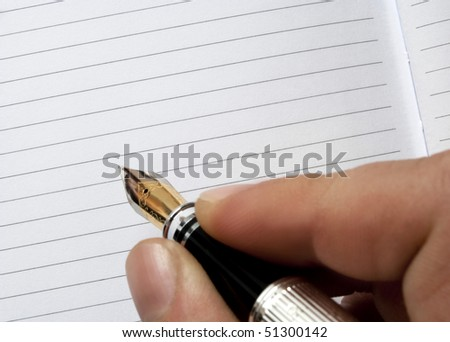 writing or signing on a blank agenda - stock photo